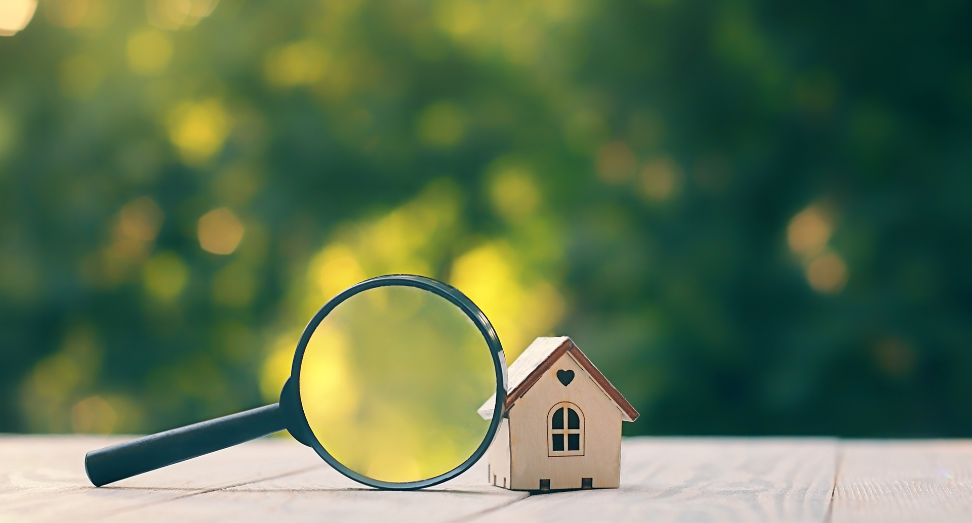 Small house on magnifying glass